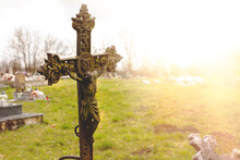 Metal Cross On The Ancient Church Cemetery.High Quality Photo.
