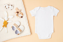 Mockup Of White Infant Bodysuit Made Of Organic Cotton With Eco Friendly Baby Accessories