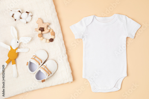 Obraz Mockup of white infant bodysuit made of organic cotton with eco friendly baby accessories - fototapety do salonu