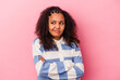 Young african american woman isolated on pink background dreaming of achieving goals and purposes