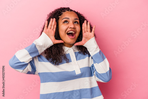 Young african american woman isolated on pink background shouting excited to front Tapéta, Fotótapéta
