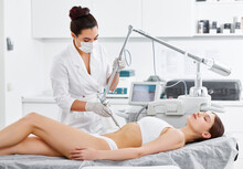 Woman Having Laser Treatment In Beauty Clinic