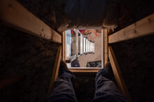 Looking Down Through The Access Opening To An Attic With The Ladder Underneath
