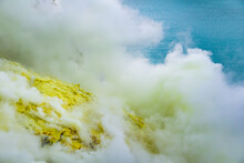 Ijen Volcano Crater And Sulphur Mining. Beautiful Landscape Mountain And Green Lake With Smoke Sulfur In The Morning In A Kawah Ijen Volcano. Beautiful Landmark From East Java, Indonesia