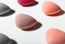 Different Makeup Sponges On White Background, Closeup