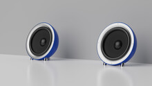 Two Computer Speakers On A Table
