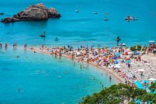 Crowds Of People Enjoying The Sunshine / Sunbathing  On A Tiny Strip Of Sand At Isola Bella Beach - The Most Beautiful Summer Destination In Sicily, Italy