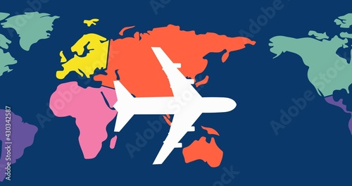 Composition of white airplane over multi coloured world map on dark blue background