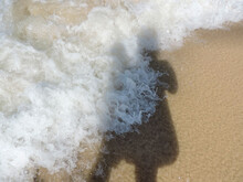 Blurred Abstract Natural Background Of Sea Water With Waves And Foam And Blurred Shadow Of Mother Holding Her Baby. Motion Blur.  Summer Vocation Concept