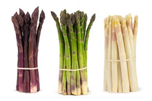 Three Bunches Of Different Fresh Asparagus Isolated On White. Purple White And Green Asparagus.