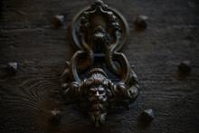 Ancient Metal Door Knocker On Wooden Door Abstract Design