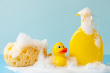 Baby Shampoo  On A White  Background, Rubber Yellow Ducks, Soap Foam. Bathroom Accessories