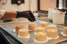 Creative Pastry Chef Adding Some Nuts On Top Of Cakes