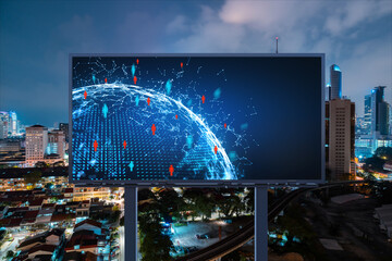 World planet Earth map hologram and social media icons on billboard over night panoramic city view of Kuala Lumpur, Malaysia, Asia. Networking and establishing new connections between people. Globe