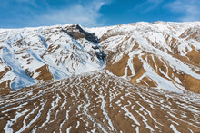 Aerial View Of Snow Melting In Springtime On Mountain Crest Along Spiti River Near Kaza Township, Himachal Pradesh, India.