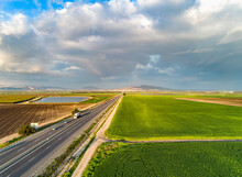 Aerial View Of Vehicles Driving The Ruler Road, A Famous Freeway Crossing The Countryside In Jezreel Valley, Northern District, Israel.