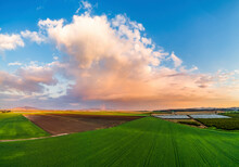 Aerial View Of A Rainbow In A Field With Rain Clouds, Jezreel Valley, Northern District, Israel.