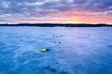 Aerial View Of Fishermen Ice Fishing On The Frozen Neman River In Kaunas, Kauno Mariu National Park, Lithuania.