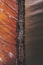 Aerial View Of Old Pier Made Of Wood And Stones In Baltic Sea, Sventoji, Lithuania.