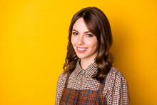 Photo Of Half Turned Young Girl Toothy Smile Look Camera Wear Checkered Clothing Isolated On Yellow Color Background