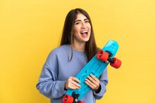 Young Caucasian Woman Isolated On Yellow Background With A Skate With Happy Expression