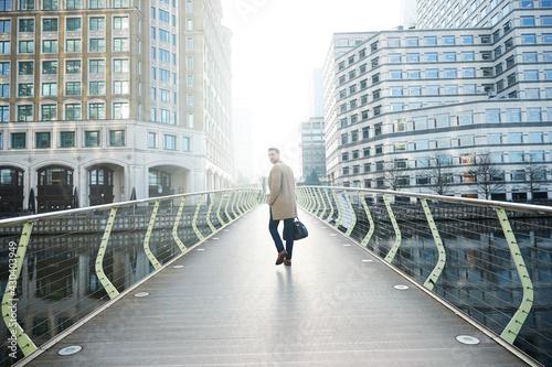 Photo UK, London, Man walking on footbridge