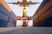Asian Women Foreman  Jumping Over In Work Area Warehouse Container And Air Plane Background . Happy Summer Holiday Concept