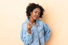 Young African American Woman Isolated On Beige Background Making Italian Gesture