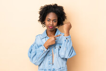 Young African American Woman Isolated On Beige Background Making The Gesture Of Being Late