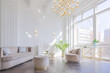 Leinwandbild Motiv very light and bright interior of luxurious cozy living room with chic soft beige furniture with gold metallic elements, huge window to the floor and wooden parquet