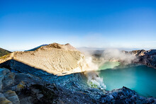 Ijen Volcano Crater With Lake And Sulphur Mining. Beautiful Landscape Mountain And Green Lake With Smoke Sulfur In The Morning In A Kawah Ijen Volcano. Beautiful Landmark From East Java, Indonesia