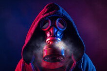 Blue And Red Illuminated Person With A Gas Mask