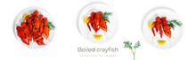 Boiled Crayfish With Dill And Lemon On Black Plate Isolated On A White Background.