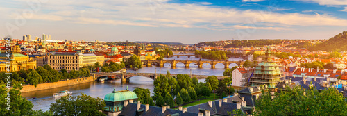 Scenic view of the Old Town pier architecture and Charles Bridge over Vltava river in Prague, Czech Republic. Prague iconic Charles Bridge (Karluv Most) and Old Town Bridge Tower at sunset, Czechia. - fototapety na wymiar