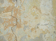 Old Wall For Texture Or Background, Rough Aged Surface, Remnants Of Peeling Plaster, Crack In The Grunge-style Wall