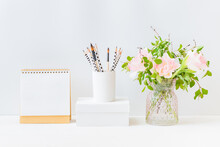 Mockup White Desk Calendar And Pink Tulips In A Vase On A Light Background