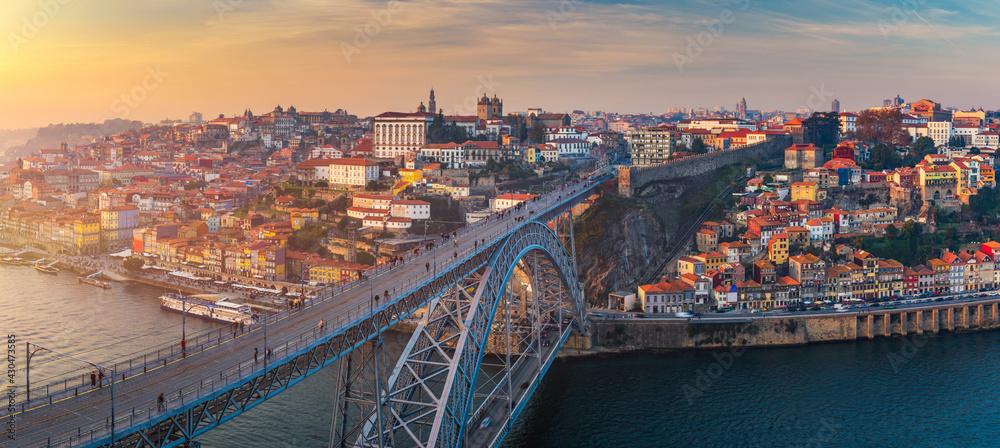 Porto panoramic aerial view of Dom Luis Bridge at sunset. Porto, Portugal. Cityscape of Porto downtown touristic Ribeira