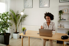 Image Of Happy Black Woman, Smiling While Speaking Or Chatting On Video Call In Office.