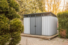 Modern Summer House Made Of Plastic. Gray Garden Shed For Garden Tools.