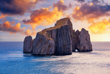 "High Cliffs Of Mediterranean Coast, ""Pan Di Zucchero"" Stack Rock In Masua, West Coast Of Sardinia, Italy. Concali Su Terrainu A Limestone Formation In Southern Sardinia, Italy."