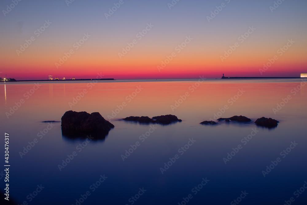 Fotografie, Obraz evening sunset on the Black Sea coast on the seaside boulevard of the hero city