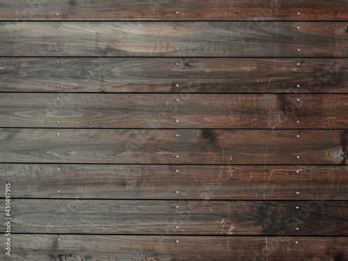 Fotografie, Obraz Closeup shot of a wooden floor with dark brown vertical tiles