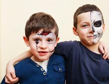 Zombie Apocalypse Kids Concept. Birthday Party Celebration Facepaint On Children Scar Face, Skeleton Together Having Fun, Halloween People