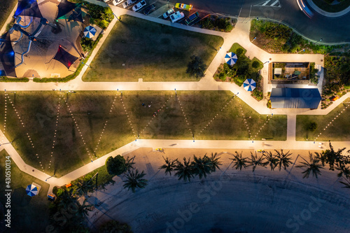 Slika na platnu Aerial overhead dusk view of a beachside park at Airlie Beach in Queensland Aust