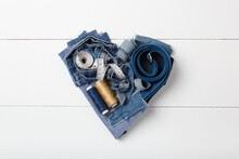 A Heart Made Of Jeans Scraps And Sewing Materials: Measuring Tape, Thread, Lace. Upcycle Old Denim Garbage. Recycling Old Jeans. Blue Jeans Cut Pieces Ready For Recycling. Save The Planet. Zero Waste