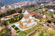 Scenic Aerial View Of Old Georgian Town Of Mtskheta In Valley Of Caucasus Mountains Overlooking Samtavro Orthodox Monastery Complex In Springtime