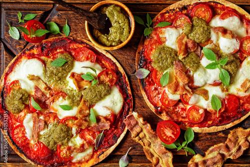 Fototapeta hot pizza with tomatoes, cheese, bacon, pesto