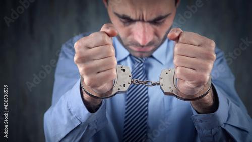 Fotografia Caucasian businessman in handcuffs. Corruption