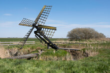 Paaltjasker In The Village Of Sondel, Friesland The Netherlands. A Tjasker Is A Small Type Of Windmill Used Solely For Drainage Purposes