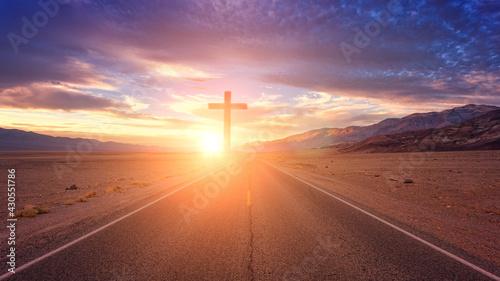 Tablou Canvas Silhouette cross on mountain sunset. Sage, flowers, sun